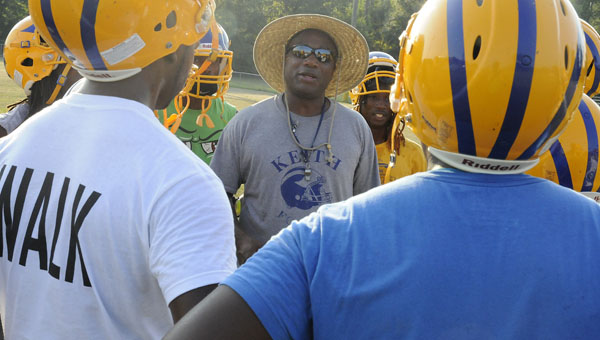 Keith head coach Harry Crum explains a special teams coverage to his players during Wednesday's practice at Keith High School. Crum, who is entering his 17th season helping coach the Bears, has led Keith to six consecutive playoff appearances.--Daniel Evans