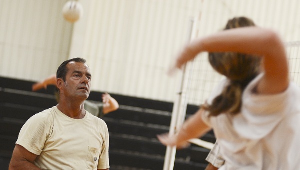 Meadowview Christian volleyball head coach Tim Burton, left, looks on during practice Thursday.  --Jay Sowers