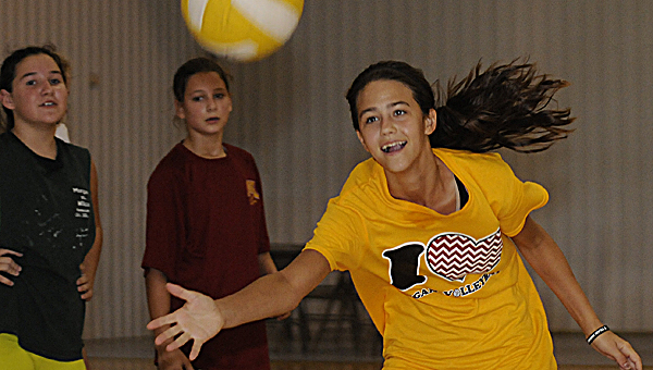 Morgan Academy's Regan Hewitt chases after the volleyball during Thursday's practice at the school. Hewitt,  a freshman, and the Senators are preparing to open their season Wednesday at Tuscaloosa Academy. --Daniel Evans
