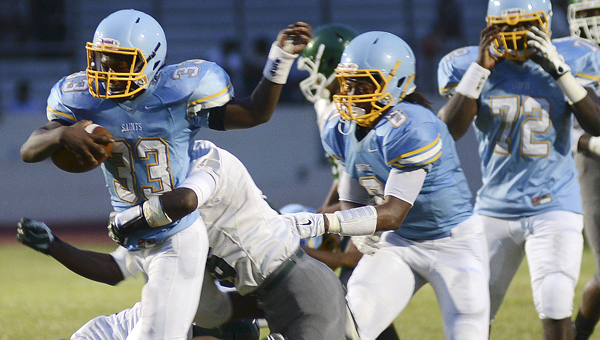 Selma running back Kerry Ford is brought down at the end of a run in the second quarter of Friday's game against Dallas County at Memorial Stadium.--Jay Sowers