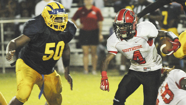 Southside HIgh School's Jhlandius Sullivan, right, eludes a Keith defender during Friday night's game. Sullivan scored a rushing touchdown, a receiving touchdown and had several big punt returns to lead the Panthers to a 40-12 victory over the Bears.--Daniel Evans