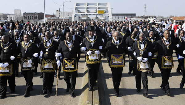 Thousands of visitors walk across the Edmund Pettus Bridge during the 49th anniversary of Bloody Sunday in March.  The 50th anniversary, scheduled for next March, has been recognized as one of the top 100 events in North America to attend by the American Bus Association.-- File Photo