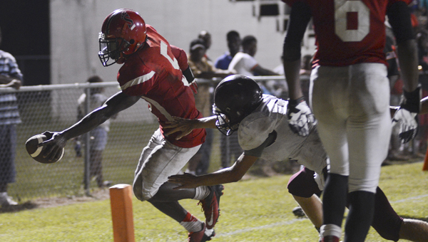 Southside starting quarterback Scott Cole, left, reaches over the goal line for a touchdown late in the Panthers' 35-19 loss to the Satsuma Gators. --Jay Sowers