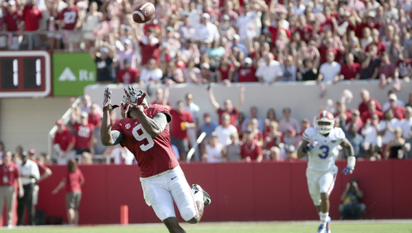 Alabama's Amari Cooper hauls in a touchdown pass in the first quarter of the Tide's SEC game against Florida Saturday in Tuscaloosa. Cooper finished the game with 10 receptions for 201 yards and three touchdowns. -- Kent Gidley | University of Alabama