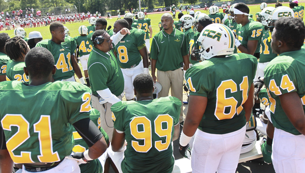 Hornets' defensive gameplan on the sideline during their game against the Southeastern. --Alaina Denean