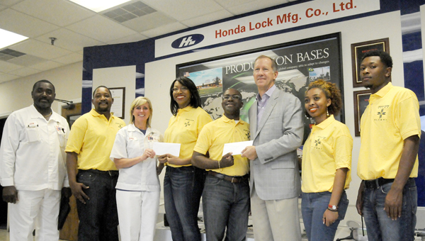 Honda Lock and The Selma Times-Journal made donations to Honda Campus All-Star Challenge team from Concordia College-Alabama. Pictured above are: (from left) John Owden, Production Coordinator and Honda Lock; Paxton Chatora, CCA student and team VP from Zimbabwe; Loren Allday, Human Resource Manager at Honda Lock; Dr. Chinwe Okeke, CCA team director, Glenn King Jr., CCA assistant team director, Dennis Palmer, publisher of The Selma Times-Journal; Gary Loftin, CCA team member and Brukty Shetta, team secretary from Ethiopia. -- Tim Reeves
