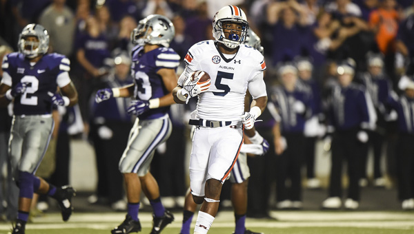 Auburn's Ricardo Louis scores a touchdown in Thursday night's 20-14 win over Kansas State .The Tigers ran for 130 yards on the ground, 200 less than their season average.  Zach Bland/Auburn Athletics