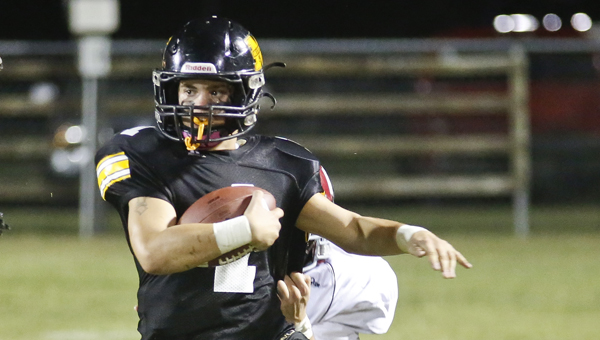 Meadowview Christian's Jonathan Sebren runs the ball against Victory Academy Friday, Sept. 19 in their annual homecoming game. Meadowview fell to Victory 56-22. --Alaina Denean