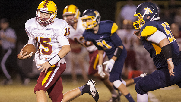 Morgan Academy quarterback Harrison Adams runs the ball against Tuscaloosa Academy Friday. The Senators lost the game 42-14. --Laura Chramer