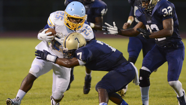 Selma's Kendarious Merchant is brought down by Bryant's Tyler Slayton during the first quarter of a high scool football game Friday, Sept. 4, 2014 at Paul W. Bryant High School. -- Kelly Lambert | The Tuscaloosa News