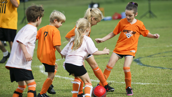 Bearcats and Boilermakers players go after the ball during their first game of the Upward Soccer season Saturday. (Alaina Denean | Times-Journal)