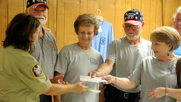 Members of Ladies Auxiliary of Veterans of Foreign Wars and VFW Post 3016 hand Selma Animal Shelter Director Nora Curtin a $150 donation meant for the Selma Animal Shelter on behalf of their groups. (Sarah Robinson | Times-Journal)