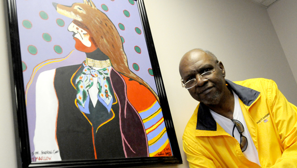 Dr. Timothy Marlow stands Tuesday in front of one of his paintings located in his doctor's office on Medical Center Parkway. -- Sarah Robinson