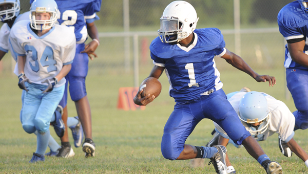 Tipton-Durant's Markendrick Williams cuts back across field in his team's 34-12 win over Martin Middle School in Tuesday's game at Southside High School.  Williams totaled 330 yards in the game and rushed for four touchdowns to lead the Blue Devils to the win.--Daniel Evans