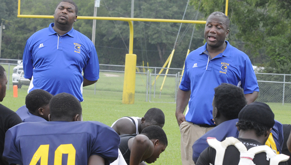 Keith head coach Harry Crum talks to his players after Saturday's loss to Maplesville. --Sarah Robinson