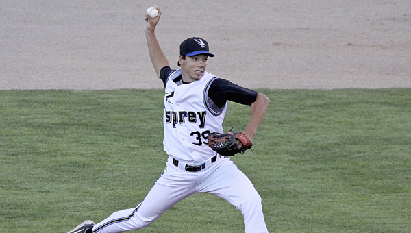 Missoula Osprey pitcher and Dallas County High School alumnus Kevin Simmons throws a pitch in a minor league game earlier this season.  Simmons finished the year with a 3.61 ERA and threw 43 strikeouts in 47.1 innings.--Missoula Osprey