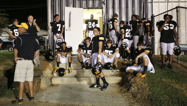 Meadowview Christian players wait outside their locker room during a lightning delay that eventually led to the postponement of their game against the Freedom Cowboys until Oct. 17.  -- Alaina Denean