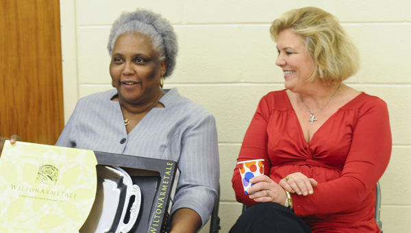 Selma City Council member Susan Keith, right, sits next to outgoing city treasurer Cynthia Mitchell Wednesday during a reception to honor Mitchell as her final day with the city of Selma will be Monday. -- Justin Averette