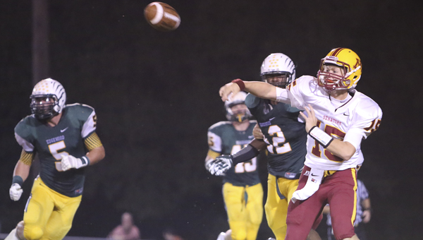 Morgan Academy quarterback Harrison Adams throws a pass in Friday night's game against Edgewood Academy. Edgewood won the game 69-14 and extended its winning streak to 49 consecutive games.--Doug Horton