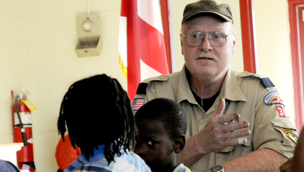 Webelos leader Alan Cozadd speaks with Knox Elementary parents and students Thursday at the school's Scout Night about joining the Boy Scouts of America's Crane district. -- Sarah Robinson