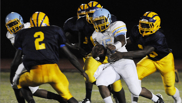 Selma's Taqwillis Chappell runs the ball against Keith in Friday night's game at Memorial Stadium. The Saints rolled to a 52-8 victory over their county rivals, using three non-offensive touchdowns to pull away. --Daniel Evans