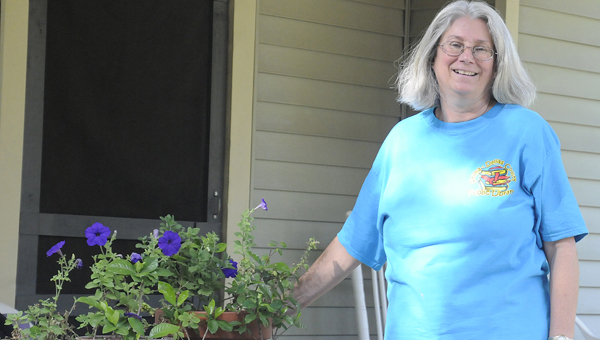 PH Miller stands in front of her house on Lamar Avenue Wednesday afternoon. -- Daniel Evans