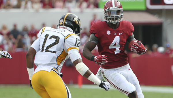 Alabama running back T.J. Yeldon looks to juke a defender for Southern Miss in Saturday's game in Tuscaloosa. -- Kent Gidley
