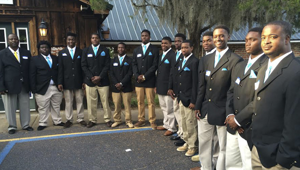 Selma High players and coaches, honored during the first week of the Training Table Program, pose for a photograph in front of the Tally Ho Restaurant.