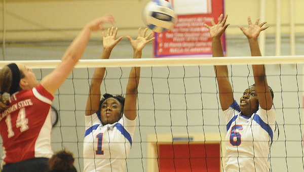 Wallace Community College Selma's Thomesha Davis, left and Jada Everett attempt to block a hard spike from a Gadsden City player during Tuesday night's match.  The match was Wallace's last home game of the season.--Daniel Evans