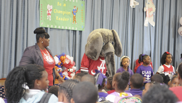 Big Al dances with the Clark Elementary faculty, staff and students Friday to a song that promotes reading. Mascot for the University of Alabama's football team, Big AL appeared at both Clark and Payne Elementary School Friday to encourage the students to read regularly. (Sarah Robinson | Times-Journal)