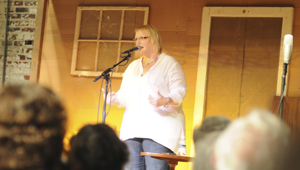 Storyteller Kim Weitkamp performs at the Alabama Tale-Tellin' Festival held Friday at ArtsRevive. The festival will continue Saturday with Swappin' Ground at 4:30 p.m. followed by Tale-Tellin' at 6:30 p.m. (Sarah Robinson | Times-Journal)