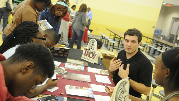 Tony Weaver, an admissions counselor for Troy University, speaks with area students at the college fair Tuesday.  Held at Selma High, the fair was collaborative effort of Selma High and the Selma Chapter of Alpha Phi Alpha Fraternity, Inc.