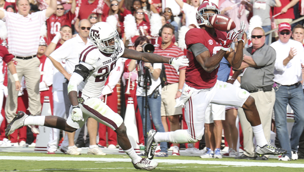 Alabama wide receiver Amari Cooper catches a pass in Saturday's 59-0 win over Texas A&M.  The Crimson Tide piled up 602 total yards of offense and Cooper had 140 yards receiving on eight catches and two touchdowns. (Kent Gidley | University of Alabama)