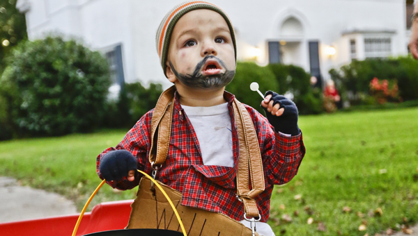 Fynn Posey take a break from trick or treating on Mallory Drive to pose for a picture. (Alaina Denean | Times-Journal)