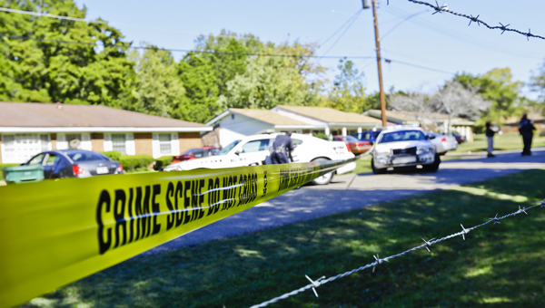 caution tape: Selma Police Department officers work the scene of a traffic stop Wednesday off Magnum Avenue.