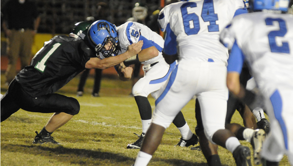 Demopolis quarterback Logan McVay is tackled by Dallas County's Jeremy Miller during Friday night's game at Memorial Stadium. The Tigers won Friday's game 41-18.--Justin Averette
