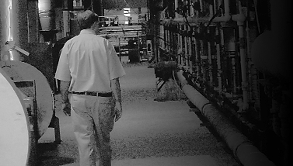 In the photo above,  Ted Henry walks next to one of the kilns at Henry Brick Company before his retirement in 2010.