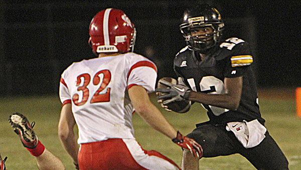 Tuscaloosa Christian's Seth Durant (32) tracks Meadowview's C.J. Grimes (12) on Oct. 3 in Tuscaloosa. --Jacob Ford