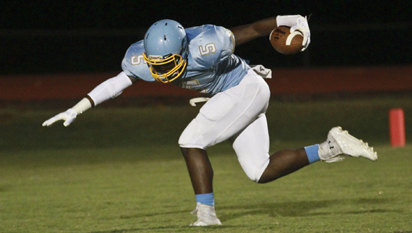 elma running back Brandon Hatcher tries to keep his footing in Friday night's game against Brookwood Friday night.  The Saints will face Bessemer City this week in a key Class 6A, Region 4 game between teams tied for third in the standings.