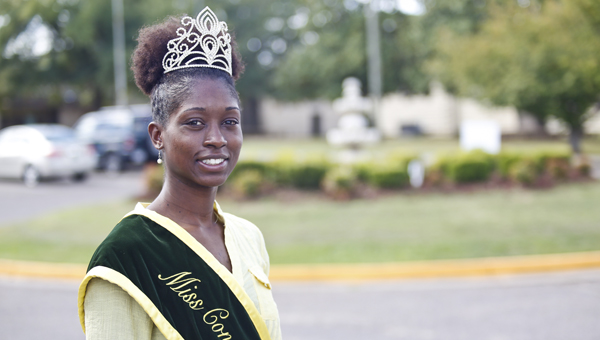Desiree Wilson, the 2014 Miss Concordia College Homecoming Queen, takes a moment to pose for a picture before going to class Tuesday.