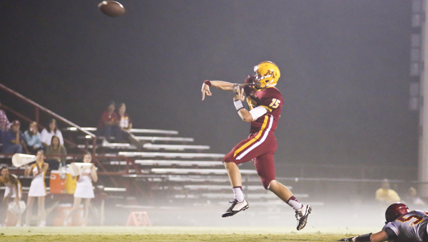 Scott Brantley (15) throws a pass during Morgan's foggy homecoming game Friday night. Morgan was shut out by Escambia, 51-0. (Alaina Denean | Times-Journal)