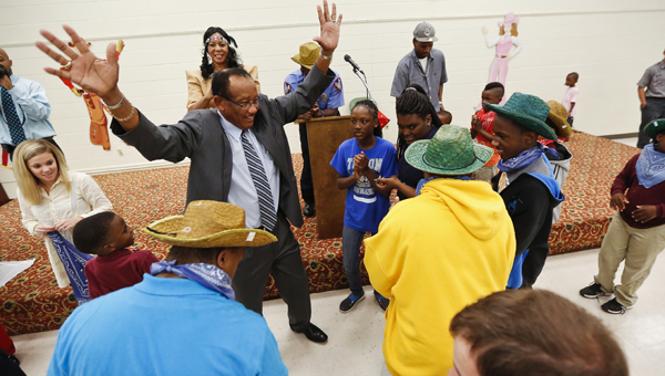 Selma Mayor George Evans dances with special needs children during his fifth annual Mayor's Charity Golf Classic Luncheon, which was held Tuesday at the Carl C. Morgan Convention Center.
