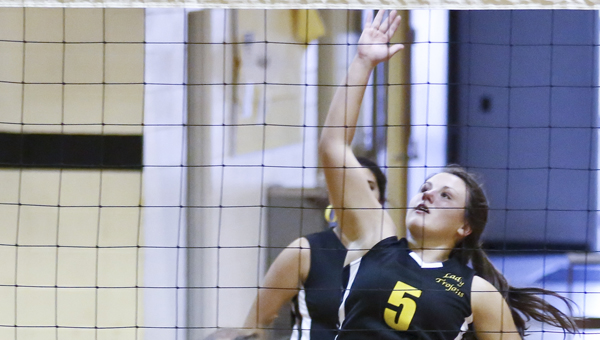 Mggie Tipton spikes the ball against Cahawba. Meadowview defeated Cahawba Christian Academy earlier this season. The Trojans will take on Chilton Christian Tuesday in a sub-state game, where the winner will advance to Friday's state tournament in Oxford. --File Photo