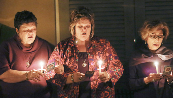 Members of the community wore purple and lit candles Thursday night at the Saint James Hotel, to recognize those who have been victims of domestic violence.  The vigil was organized by SABRA Sanctuary. (Alaina Denean | Times-Journal)