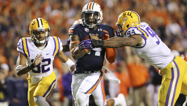 Auburn quarterback Nick Marshall runs for a touchdown in Saturday's game against LSU. The Tigers won the game 41-7 to improve to 5-0 on the season.--Doug Horton