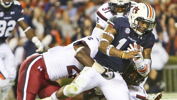 Auburn quarterback Nick Marshall falls across the goal line in Saturday's game against South Carolina. --Alaina Denean