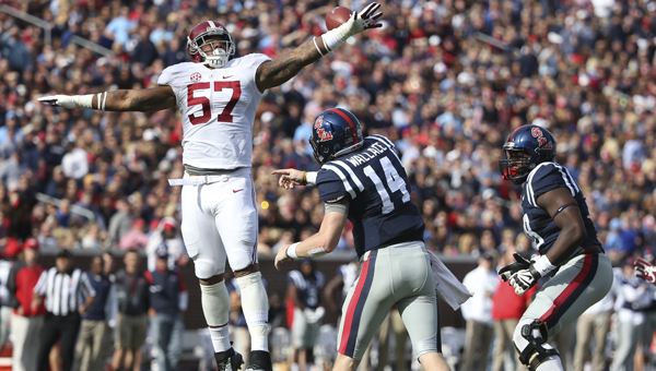 Alabama linebacker D. J. Pettway tries to knock down a pass thrown by Mississippi quarterback Bo Wallace during Saturday's game in Oxford.  Wallace and the Rebels pulled the 23-17 upset over the No. 1 ranked team in the coaches poll, Mississippi's first ever win versus a top-ranked team.--Kent Gidley | University of Alabama