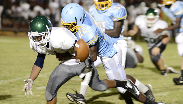 The ball pops out of the hands of Dallas County running back Calvin Starks Jr., left, after he was hit by Selma linebacker Quintz Blevins in a game earlier this year. Hornets' head coach Marty Smith said turnovers will be one of the keys for his team this week against Central Tuscaloosa. --File Photo