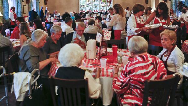 Guests enjoy their lobster dinner during the annual Lobesterfest at St. Paul's Episcopal Church on Thursday.--Alaina Denean