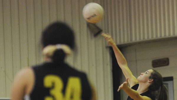 eadowview Christian's Maggie Tipton hits a reverse shot in Tuesday's match against Chilton Christian Academy. --Daniel Evans